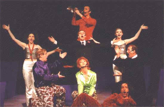 "The cast performing the title song ""Stiff!"""