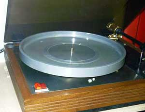 Transcription turntable with platter inverted to check belt alignment